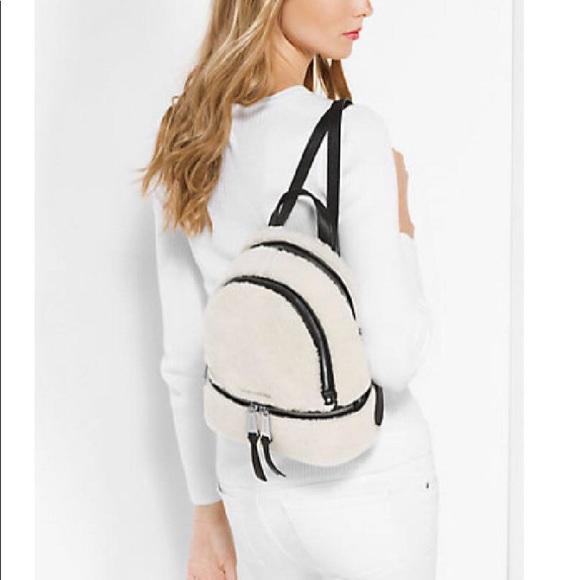 daa6eb3dd50238 Michael Kors Bags | Rhea Zip Small Naturalblack Leather Fur Backpack ...